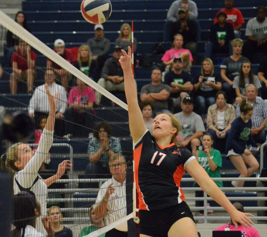Aledo senior setter Erin Weiss executes a setter tip for a kill Friday night during the Ladycats' victory at Eaton. Weiss recorded three crafty setter tips in the match and finished with four kills overall.